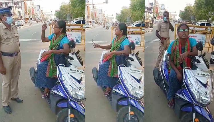 இத்துனோண்டு மாஸ்குக்கு 200 ரூபாய் அபராதாமா..? நானும் ரவுடிதான் தான் பாத்துக்க... போலீசையே மிரட்டிய பெண்